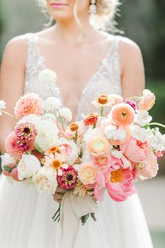 bride holding bouquet with peach, apricot, ivory, and pink flowers and neutral ribbons, Intricate dutch braided low updo that's elegant and just slightly messy for a whimsical look, Estancia La Jolla wedding by Cavin Elizabeth Photography #weddingcolors