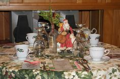 The tablescape.  No two tables are the same.  I like using different table toppers, Santas, bottles, etc. on each table.