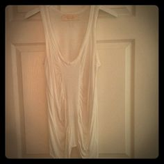 Zara Hi-back & Low-front Top in White Size M Zara Hi-back & Low-front Top in White. Size Medium. Pre-loved but in good condition. Great summer top to pull over bikini and wear w shorts! Casual yet sexy! Zara Tops