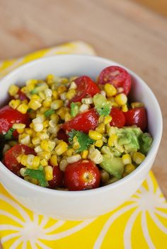 Corn Avocado Salad:  2 avocados, 1 can corn, 1/2 pint cherry tomatoes, 2 green onions; 3 tbsp olive oil, 2 tbsp lime juice, 2 tsp parsley, salt & pepper, 2 tsp minced garlic, 1 tbsp honey ... even my kids loved this one!
