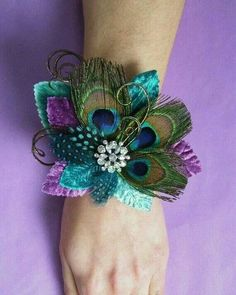 Peacock themed corsage