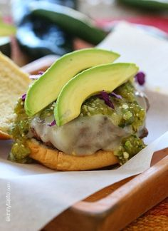 Wow, these Salsa Verde Burgers are OFF THE HOOK! If you need a new burger idea that everyone will love, look no further. These burgers are lean with a mean, green kick topped with pepper jack cheese, salsa verde and avocado – delish!     I shared this delicious homemade salsa verde recipe for Better Homes and Gardens on Delish Dish and decided to make these burgers using the salsa for dinner last night. You can also use store bought salsa verde, but trust me, nothing beats homemade!      I m...