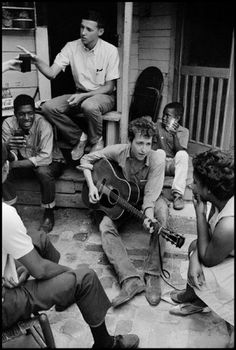 Bob Dylan plays on the back porch of the Student Nonviolent Coordinating Committee office, 1963.  © Danny Lyon / Magnum Photos
