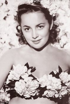 """While everyone was ga ga over Clark Gable and Vivien Leigh, and rightly so, I fell in love with the beautiful Olivia deHavilland as Melanie Hamilton in """"Gone With The Wind"""". One of my proudest possessions is a personal handwritten letter I received from Olivia in response to a professionally calligraphed love letter on parchment I sent her. What a little fool I was but hey -- she really did appreciate it. (See also Favorite Movies Board)"""