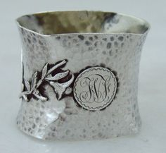 Wood & Hughes Aesthetic period hammered coin silver napkin ring with applied decoration - New York, c1880 (Berry & Co)