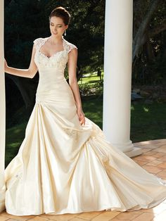 Taffeta A-line gown with crystal hand-beaded lace Empire bodice and Queen Anne neckline and cap sleeves and open keyhole back$169.00