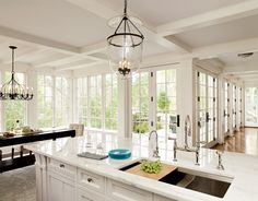 Will have a huge white kitchen that's open to everything else because people always congregate in the kitchen