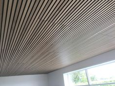 This is a sound dampening ceiling made from our Akupanels. When you install the panels in the standard way is to install them in extension of each other.   This creates a gap of 3 mm between the lamellas on each panels, which creates a nice look on the ceiling.   This is the Akupanel - Rustic Natural Oak. Reuse Plastic Bottles, Sustainable Forestry, Sound Absorbing, Help The Environment, Slat Wall, Acoustic Panels, Subtle Textures, Sunroom, Ceilings