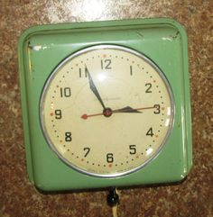 GE kitchen wall clock, jadite green - I would like to have on in the new kitchen, especially since there's a specialized wall clock electrical outlet in the wall over  the counter where we will be installing a gas cooktop.