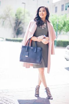 Blush drape coat over an olive sheath dress with caged heels.