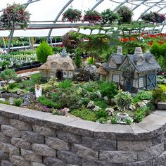 Fairy garden with Gnomenculture / The Fairy's Garden fairy cottages ~ http://miniature-gardening.com/miniature_gardens_large_scale_garden_gallery/