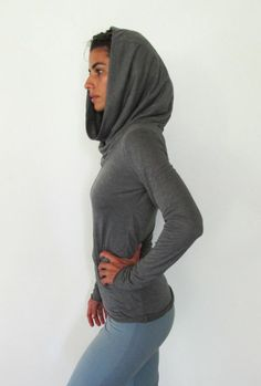 Longsleeve top with cowel neck that doubles as a hood. Yoga clothes - lounge wear - dance. Charcoal grey. $49.75, via Etsy.