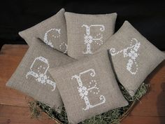 This set of five mini pillows / bowl fillers are cross stitched by me with white DMC floss onto line burlap. Each one measures 5 x 5 and is gently filled with polyfil. They are backed with a coordinating cotton calico fabric. These would make a great housewarming gift! Custom orders welcome! Any word or phrase as long as its clean! in any color. Cost and shipping may change with length of order. Thanks for looking