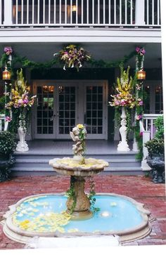 Floral Decor for ceremony at the Courtyard at Lake Lucerne, designed by Lana with Fairbanks Florist.