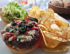 Basco Burger - Beef or Chicken Burger, Goat Cheese, mozzarella, dried tomato, red pepper & black olives, on special bread with potato chips
