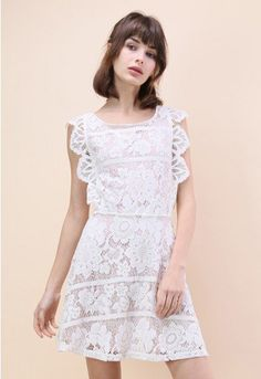 Make a little white noise at the spring soirees this year with our endearing lace dress. A shorter hemline keeps it youthful while the lace and exposed cross-back keep it fun and alluring. Style with metallic heels for a sparkling finish.  - Floral lace finished - Cross-straps to reverse - Open back - Eyelet detail - Concealed back zip closure - Lined - 100% polyester - Hand wash  Size(cm)Length Bust Waist   XS        92    86    76 S         93    90    80…