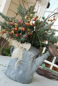 Watering can with Christmas greens