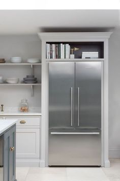 Fisher & Paykel fridge freezer housed in Nickleby cabinetry with storage space above for cookbooks. Fisher & Paykel fridge freezer housed in Nickleby cabinetry with storage space above for cookbooks. Fridge Storage, Kitchen Storage, Food Storage, Fridge Shelves, Storage Hacks, Storage Cabinets, Storage Organization, Storage Ideas, Kitchen Living