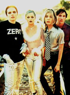 THE SMASHING PUMPKINS - Chicago, United States (1988 – 2000, 2007 – present) are an alternative rock band, formed in Chicago, Illinois, USA, in 1988. Billy Corgan and James Iha met in a record store, and began performing in local nightclubs with their bassist, D'Arcy Wretzky, using a drum machine. Playing with a drum machine frustrated both the band and their audience, and so Chicago jazz drummer Jimmy Chamberlin was hired soon afterwards.