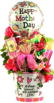 """This wonderful Mother's Day gift basket features a beautiful planter, perfect for spring flowers, adorned with elegant silk flowers and topped with a designer bow and a """"Happy Mother's Day"""" balloon. It features a wonderful sentiment and is filled with delicious sweets!"""