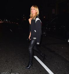 Three's company: Bella brought along her pal Hailey Baldwin, who rocked a pair of leather trousers and boots