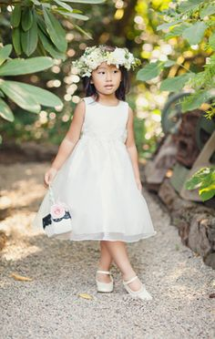 This flower girl wears ballet slippers and sports a pink basket flower just like Cami! #flowergirlstyle #adorable