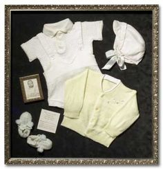 Framed Baby Clothes. Marie Osmond did this and I loved it for a blessing outfit.