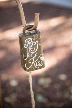 Ring for a kiss! This adorable cowbell is a sweet and fun touch to a #rustic wedding {Michael Anthony Photography}