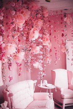 aesthetic Pink room with pink chairs and pink flowers falling / trailing from the ceiling . Pink room with pink chairs and pink flowers falling / trailing from the ceiling