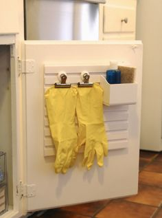 Use a Martha Stewart Wall Manager to organize the small space under your kitchen sink!