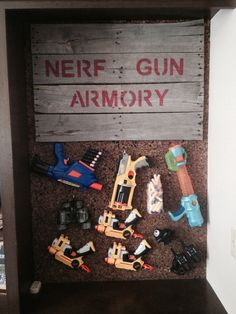 Nerf Gun Armory for boy's room. Pallet sign; Nerf gun and spy gear organization.