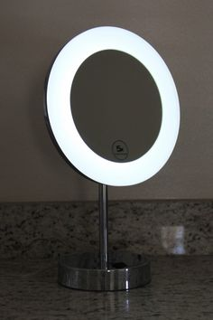 "Lighted Image presents this 10"" free standing LED illuminated make up mirror perfect for your vanity top or whereever you desire. The stylish chrome finish not only looks great but protects your make up mirror from potential moisture and condensation. With 5x magnification and a flexible face, it is the ideal solution for personal grooming applications to ensure you are always looking your best."