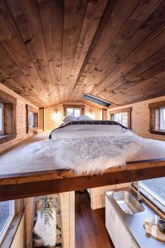 This large bedroom loft has a skylight and five windows.