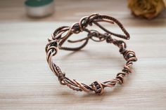 Unique handcrafted wire wrapped bangle copper bracelet for a very special girl. This design is very delicate and yet whimsical and eye-catching featuring little leafs wrapping around the wrist. It will fit either your office dress code or evening gown which makes it a true treasure of your