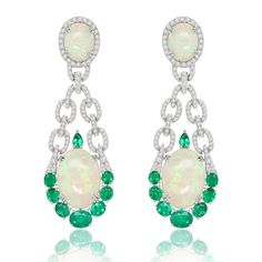 Welo opals, emeralds and white diamonds tap into the play of colours contained in these Sutra earrings. Find out everything you need to know about opulent opals: from the green, blue, purple, orange hue to the location, and the important designers using the gemstone: http://www.thejewelleryeditor.com/jewellery/know-your-opals-welo-australian-mexican-jewellery/ #jewelry
