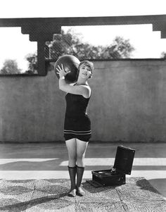 betty compson exercises with a medicine ball. flapper fitness, yo!