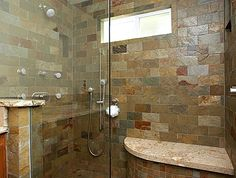 This looks a lot like my dad's shower, only with lighter tile.
