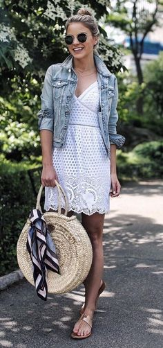 easy breezy spring outfit with white lacey dress and jean jacket rolled up.