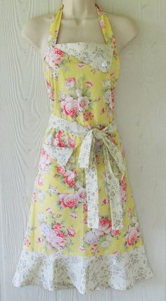 Dressed up and kitchen ready! This vintage style full apron is a beautiful floral print of cottage roses on a butter yellow background.
