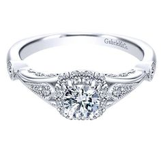14K White Gold .67cttw Vintage Cushion Halo Diamond Engagement Ring. This ready to wear diamond engagement ring, features .67cttw of round diamonds with an engraved vintage style white gold shank with