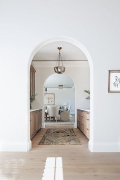Kate Marker Interiors - Stoffer Photography - An arch doorway leads to galley style butler's pantry boasting a tan and gray vintage rug placed on a light gray wash wooden floor. Style At Home, Home Design, Design Design, Modern Farmhouse, Farmhouse Style, Farmhouse Interior, Farmhouse Sinks, Farmhouse Lighting, Farmhouse Decor