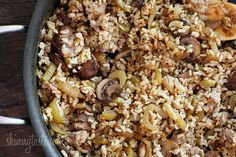 Brown rice stuffing made with Italian chicken sausage, celery, mushrooms, and onions. Serve this as a Thanksgiving side dish or you can even enjoy this as a meal. It's so good and naturally gluten free!  Chicken Sausage Brown Rice Stuffing with Celery and Mushrooms | Skinnytaste