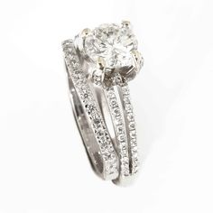 Claw set multi diamond engagement ring with shaped wedding band and matching diamond setting.