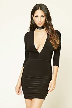 A stretch-knit bodycon dress featuring a deep V-neckline, 3/4 sleeves, and a ruched skirt accent.