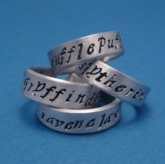 Harry Potter Inspired - Choose ONE - Gryffindor, Slytherin, Hufflepuff, and Ravenclaw - A Hand Stamped Aluminum Ring by chasingatstarlight on Etsy https://www.etsy.com/listing/93792656/harry-potter-inspired-choose-one