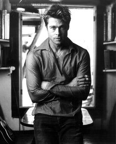 Brad Pitt with his arms folded