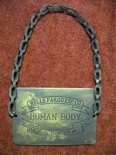 human body tag, probably used in shipping the deceased back to the family by train.