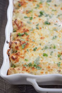 These from-scratch chile chicken enchiladas are amazing! And the quick and easy, creamy white sauce takes them over the top! #enchiladas #dinner #greenchile #maindish #familydinner #melskitchencafe