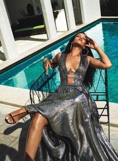 Posing by the pool, Rihanna wears Alberta Ferretti dress and Christian Louboutin sandals with Jennifer Fisher earrings