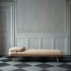Need a Sunday nap? Take it in the gorgeous Spine Daybed crafted in soft natural leather and solid oak.